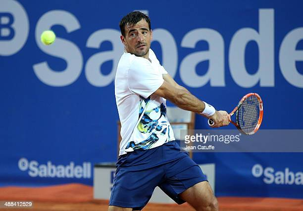 Ivan Dodig of Croatia in action against Rafael Nadal of Spain during day four of the ATP Tour Open Banc Sabadell Barcelona 2014 62nd Trofeo Conde de...