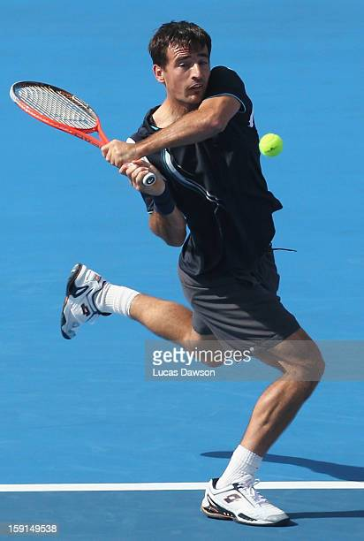 Ivan Dodig of Croatia plays a backhand during his match against Tomas Berdych of Czech Republic during day one of the AAMI Classic at Kooyong on...
