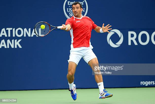 Ivan Dodig of Croatia plays a shot against Borna Coric of Croatia during Day 1 of the Rogers Cup at the Aviva Centre on July 25 2016 in Toronto...