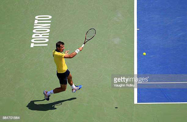 Ivan Dodig of Croatia plays a shot in a doubles semifinal match with teammate Marcelo Melo of Brazil against Florin Mergea and Horia Tecau of Romania...