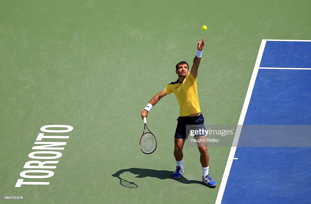 Ivan Dodig of Croatia serves in a doubles semifinal match with teammate Marcelo Melo of Brazil against Florin Mergea and Horia Tecau of Romania during Day 6 of the Rogers Cup at the Aviva Centre on July 30, 2016 in Toronto, Ontario, Canada.