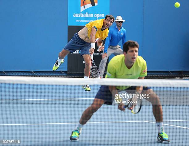Ivan Dodig of Croatia serves in his first round doubles match with Marcelo Melo of Brazil against Aljaz Bedene and Dustin Brown of Germany during day...