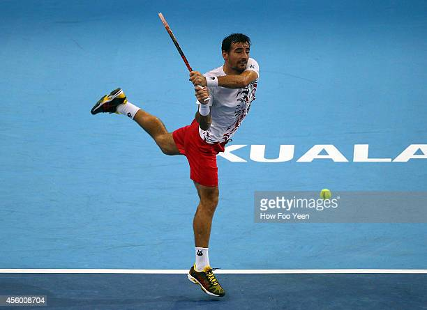 Ivan Dodig of Crotia plays a return shot to Pablo Cuevas of Uruguay during the Malaysian Open at Putra Stadium on September 24 2014 in Kuala Lumpur...