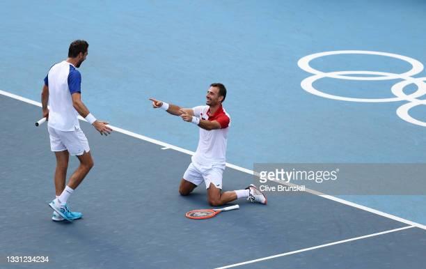 Ivan Dodig of Team Croatia and Marin Cilic of Team Croatia celebrate victory over Michael Venus of Team New Zealand and Marcus Daniell of Team New...