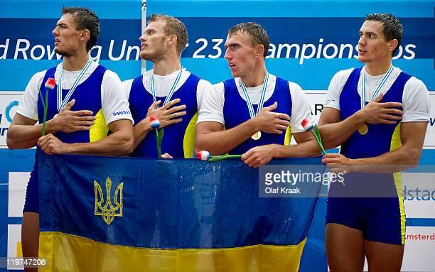 Ivan Dovgodko Olexandr Nadtoka Ivan Futryk and Yurly Ivanov of Ukraine celebrate on the winners podium after winning the Men's Quadruple Sculls...