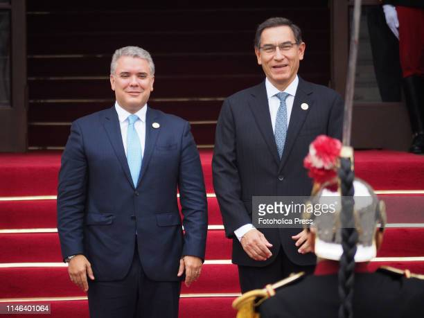 Ivan Duque, President of Colombia and Martin Vizcarra, President of Peru , receiving the salute from the Government Palace guard as part of the...