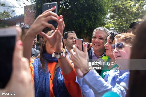 Supporters celebrate during an election rally for Ivan Duque Colombia's presidentelect not pictured at the party's headquarters in Bogota Colombia on...