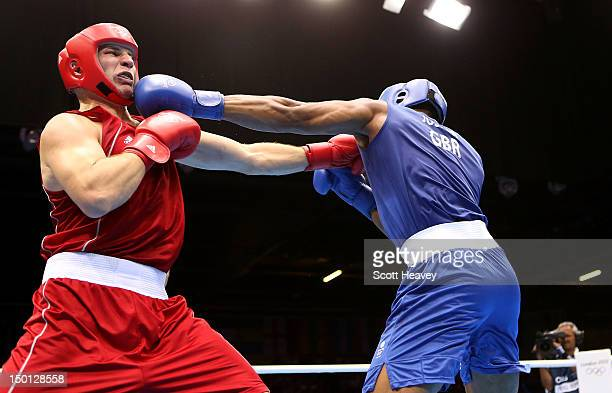Ivan Dychko of Kazakhstan competes against Anthony Joshua of Great Britain during their Men's Super Heavy Boxing semifinal bout on Day 14 of the...
