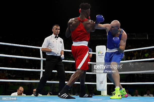 Ivan Dychko of Kazakhstan fights against Efe Ajagba of Nigeria during the Men's Super Heavy Quarterfinal 4 on Day 11 of the Rio 2016 Olympic Games at...