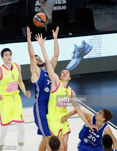 Ivan Fevrier #77 of U18 CFBB Paris competes with Altin Islamovic #7 of U18 Mega Bemax Belgrade in action during the EuroLeague Basketball Adidas Next...