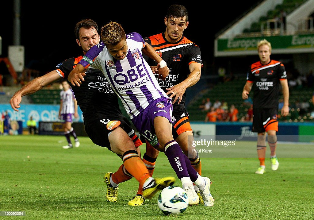 Ivan Franjic and Jack Hingert of the Roar challenge Ryo Nagai of the Glory during the round 18 A-League match between the Perth Glory and the Brisbane Roar at nib Stadium on January 26, 2013 in Perth, Australia.