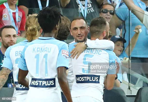 Ivan Franjic of City FC celebrates after scoring the first goal with City FC interim coach Michael Valkanis during the round 14 ALeague match between...
