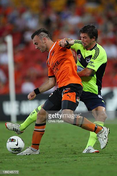 Ivan Franjic of the Roar and Harry Kewell of the Victory compete for the ball during the round 20 ALeague match between the Brisbane Roar and the...