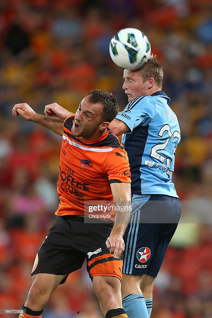 Ivan Franjic of the Roar and Rhyan Grant of Sydney FC compete for the ball during the round 27 A-League match between the Brisbane Roar and Sydney FC at Suncorp Stadium on March 28, 2013 in Brisbane, Australia.