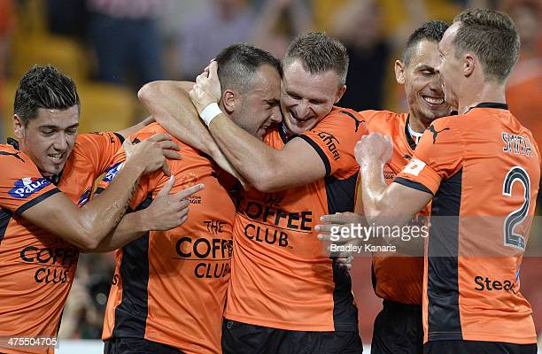 Ivan Franjic of the Roar celebrates with team mates after scoring a goal during the round 21 ALeague match between Brisbane Roar and Perth Glory at...