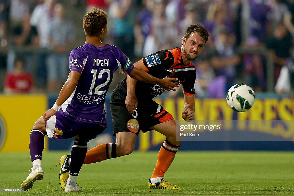 Ivan Franjic of the Roar is challenged by Ryo Nagai of the Glory during the round 18 A-League match between the Perth Glory and the Brisbane Roar at nib Stadium on January 26, 2013 in Perth, Australia.