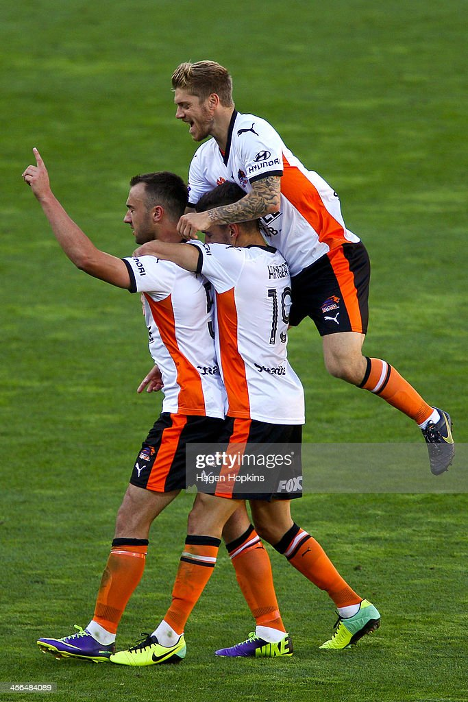 Ivan Franjic of the Roar is congratulated by teammates Jack Hingert and Luke Brattan after scoring a goal during the round 10 A-League match between the Wellington Phoenix and Brisbane Roar at Westpac Stadium on December 14, 2013 in Wellington, New Zealand.