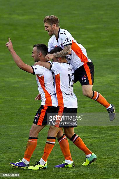 Ivan Franjic of the Roar is congratulated by teammates Jack Hingert and Luke Brattan after scoring a goal during the round 10 ALeague match between...