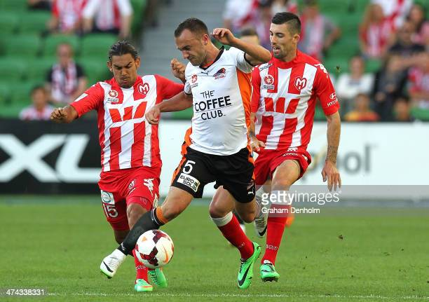 Ivan Franjic of the Roar is surrounded by the Heart defence during the round 20 ALeague match between Melbourne Heart and Brisbane Roar at AAMI Park...