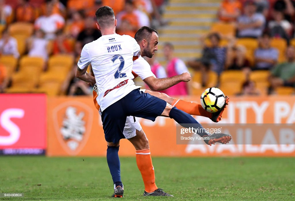 Ivan Franjic of the Roar takes on the defence of Storm Roux of the Mariners during the round 25 A-League match between the Brisbane Roar and the Central Coast Mariners at Suncorp Stadium on March 31, 2018 in Brisbane, Australia.