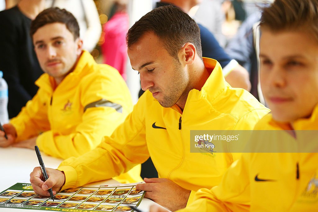Ivan Franjic signs autographs for fans during an Australian Socceroos public appearance at Westfield Sydney on November 12, 2013 in Sydney, Australia.
