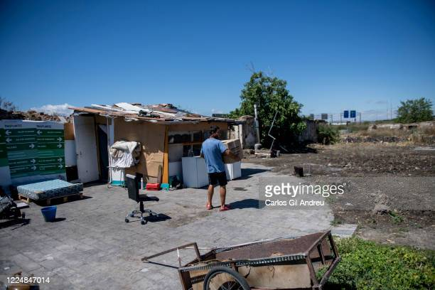 Ivan from Romania holds a Red Cross aid box outside the city where he lives in a shack with no electricity nor running water on May 13 2020 in...