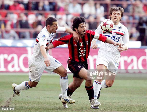 Ivan Gattuso of Milan battles with Angelo Palombo and Vitali Kutuzov of Sampdoria during the Serie A match between AC Milan and Sampdoria at the...