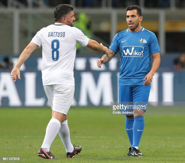 Ivan Gennaro Gattuso greets Carlos Tevez during Andrea Pirlo Farewell Match at Stadio Giuseppe Meazza on May 21 2018 in Milan Italy