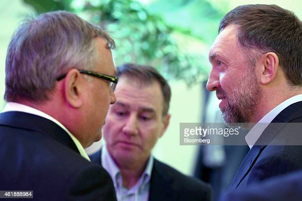 Ivan Glasenberg billionaire and chief executive officer of Glencore Xstrata Plc center pauses as he speaks with Oleg Deripaska billionaire and chief...