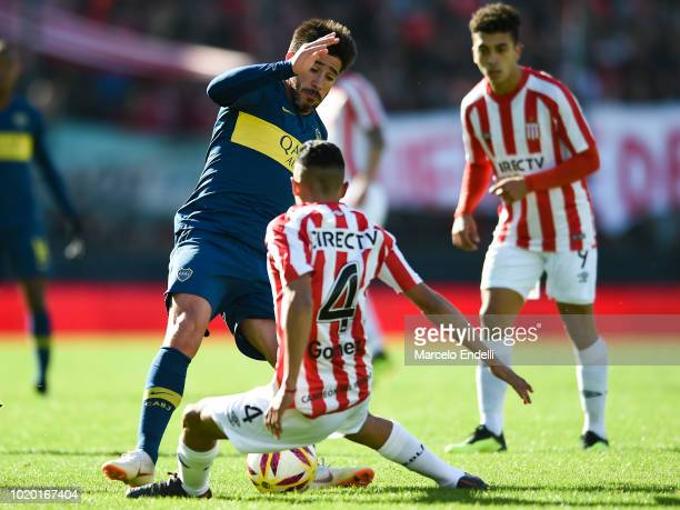 Ivan Gomez of Estudiantes fights for the ball with Pablo Perez of Boca Juniors during a match between Estudiantes and Boca Juniors as part of...