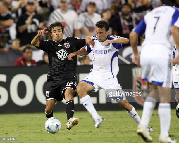 Ivan Guerrero of DC United gets to the ball beforeKerry Zavagnin of the Kansas City Wizards during an MLS match at RFK Stadium on August 2 2008 in...
