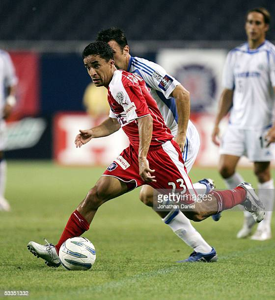 Ivan Guerrero of the Chicago Fire looks to pass downfield under pressure from Kerry Zavagnin of the Kansas City Wizards on August 10 2005 at Soldier...