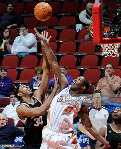 Ivan Harris of the Erie Bayhawks goes for a rebound against Patrick Sanders of the Iowa Energy on February 23 2009 at Wells Fargo Arena in Des Moines...