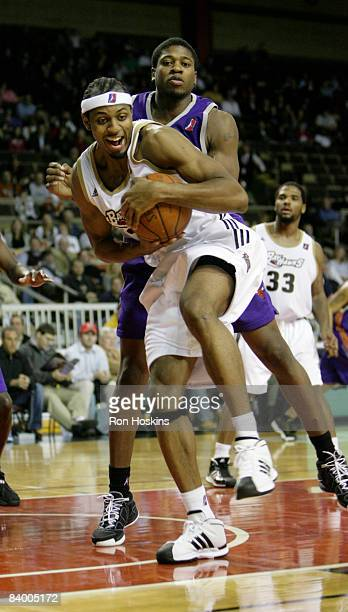 Ivan Harris of the Erie BayHawks rebounds over Cartier Martin of the Iowa Energy at Tullio Arena on December 11 2008 in Erie Pennsylvania The...