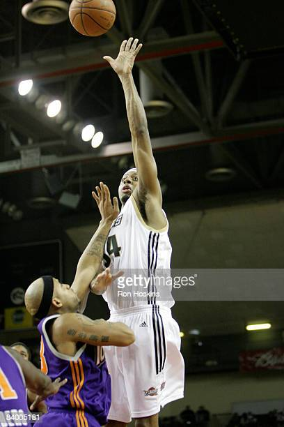 Ivan Harris of the Erie BayHawks shoots over a Iowa Energy defender at Tullio Arena on December 11 2008 in Erie Pennsylvania The BayHawks defeated...