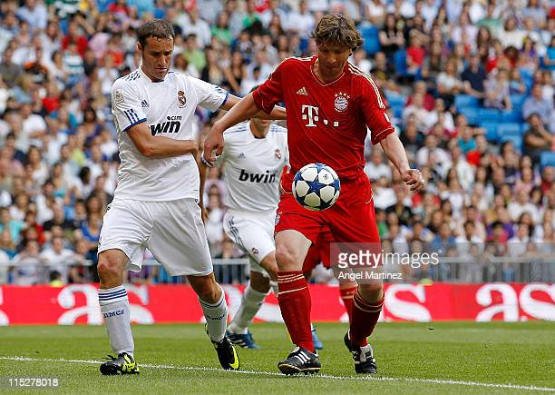 Ivan Helguera of Real Madrid duels for the ball with Michael Tarnat of Bayern Muenchen during the Corazon Classic Match between Allstars Real Madrid...