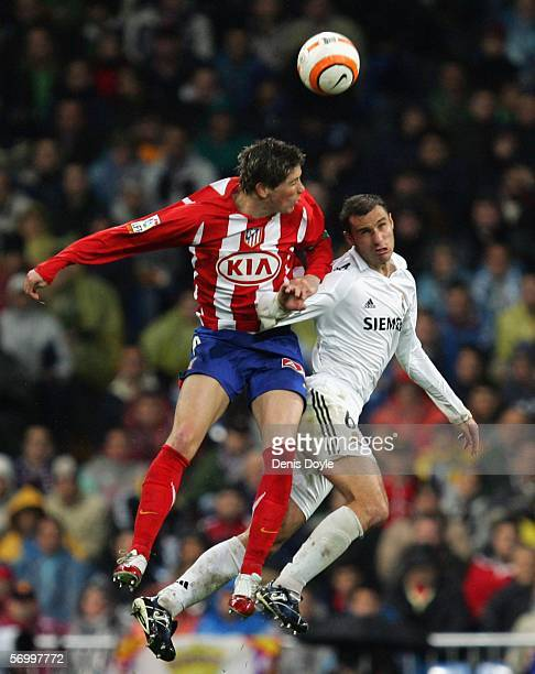 Ivan Helguera of Real Madrid goes for a high ball against Fernando Torres of Atletico Madrid during the Primera Liga match between Real Madrid and...