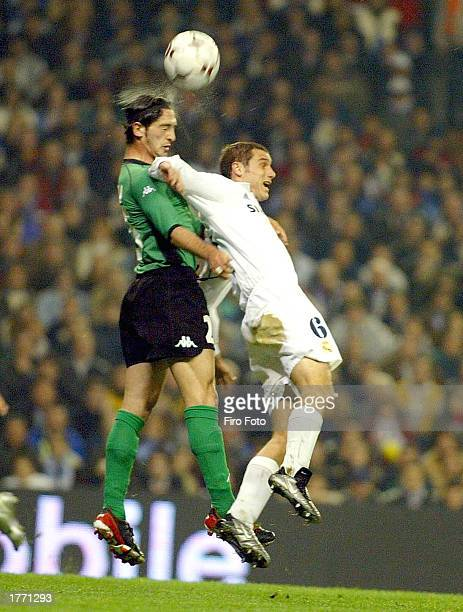 Ivan Helguera of Real Madrid goes up for a headber with Valera of Betis during the La Liga match between Real Madrid and Real Betis played at the...