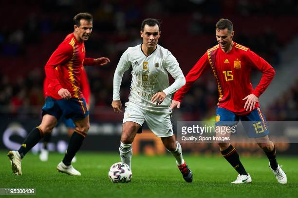 Ivan Helguera of Spanish National Team Legends battle for the ball with Marquez of Goldstandard during a frienly match at Wanda Metropolitano on...