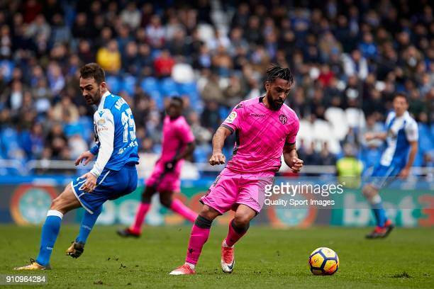 Ivan 'Ivi' Lopez of UD Levante attempts to get away from Adrian Lopez of Deportivo de La Coruna during the La Liga match between Deportivo La Coruna...