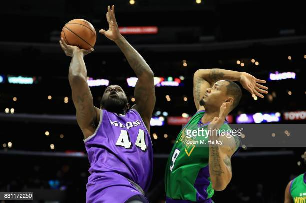Ivan Johnson of Ghost Ballers drives past Rashard Lewis of 3 Headed Monsters during week eight of the BIG3 three on three basketball league at...