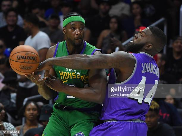 Ivan Johnson of Ghost Ballers guards Kwame Brown of the 3 Headed Monsters during the BIG3 game at Staples Center on August 13 2017 in Los Angeles...