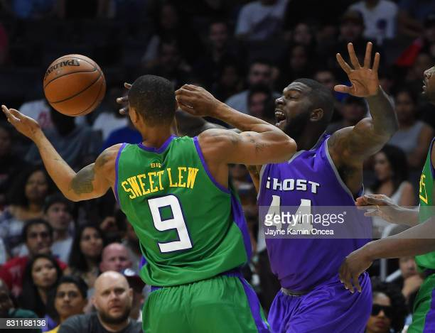 Ivan Johnson of Ghost Ballers guards Rashard Lewis of the 3 Headed Monsters during the BIG3 game at Staples Center on August 13 2017 in Los Angeles...