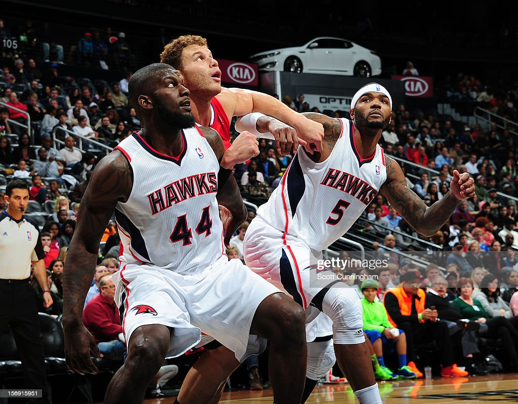 Ivan Johnson #44 (L) of the Atlanta Hawks , Blake Griffin #32 (C) of the Los Angeles Clippers, Josh Smith #5 (R) of the Atlanta Hawks all wait for the rebound at Philips Arena on November 24, 2012 in Atlanta, Georgia.