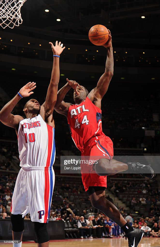 Ivan Johnson #44 of the Atlanta Hawks goes to the basket against Greg Monroe #10 of the Detroit Pistons during the game on March 9, 2012 at The Palace of Auburn Hills in Auburn Hills, Michigan.