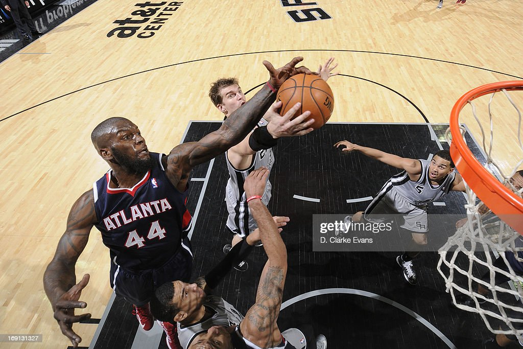 Ivan Johnson #44 of the Atlanta Hawks reaches for a rebound against Tiago Splitter #22 of the San Antonio Spurs on April 6, 2013 at the AT&T Center in San Antonio, Texas.