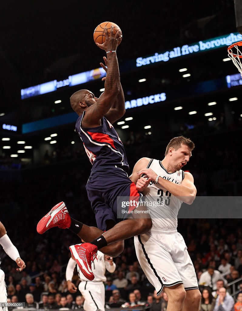 Ivan Johnson #44 of the Atlanta Hawks scores over Mirza Teletovic #33 of the Brooklyn Nets at the Barclays Center on March 17, 2013 in New York City.