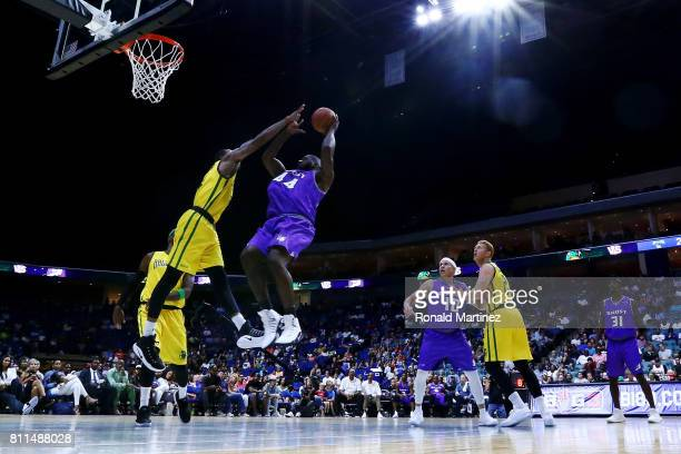 Ivan Johnson of the Ghost Ballers attempts a shot while being guarded by Rasual Butler of the Ball Hogs during week three of the BIG3 three on three...