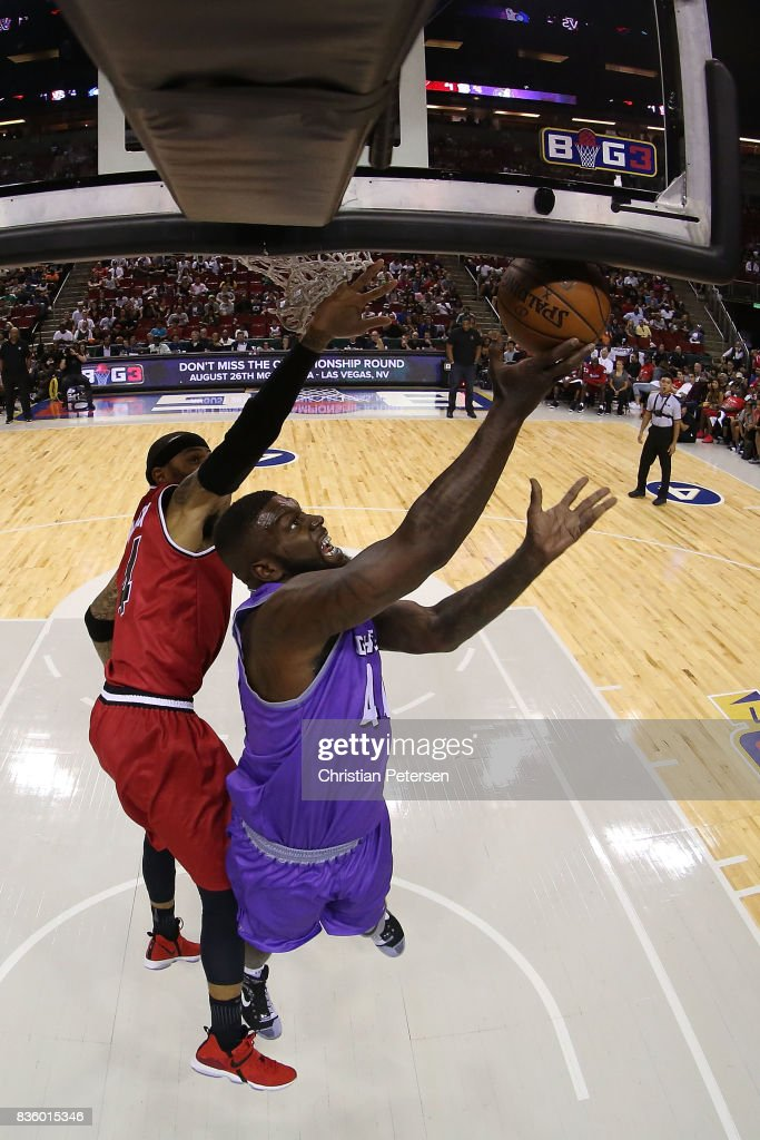 Ivan Johnson #44 of the Ghost Ballers drives the ball against Kenyon Martin #4 of the Trilogy in week nine of the BIG3 three-on-three basketball league at KeyArena on August 20, 2017 in Seattle, Washington.