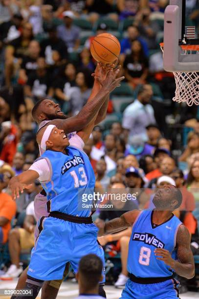 Ivan Johnson of the Ghost Ballers fights for a rebound with Jerome Williams of the Power during the BIG3 three on three basketball league runnerup...